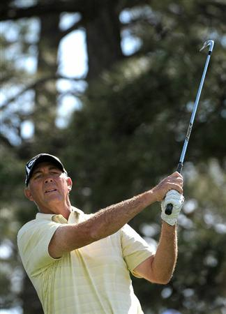 PARKER, CO. - MAY 28: Tom Lehman hits his tee shot to the par three 11th hole during the second round of the Senior PGA Championship at the Colorado Golf Club on May 28, 2010 in Parker, Colorado.  (Photo by Marc Feldman/Getty Images)