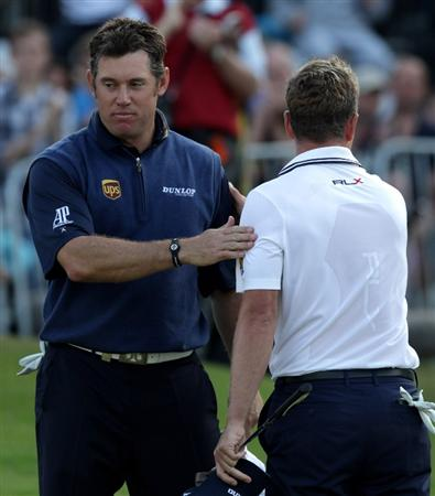 VIRGINIA WATER, ENGLAND - MAY 29:  Lee Westwood of England congratulates Luke Donald of England on victory in the playoff during the final round of the BMW PGA Championship  at the Wentworth Club on May 29, 2011 in Virginia Water, England.  (Photo by Ross Kinnaird/Getty Images)