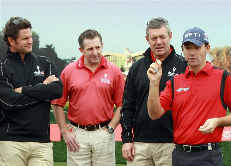 ABU DHABI, UNITED ARAB EMIRATES - JANUARY 22:  Padraig Harrington of Ireland (R) offers advice to ( L to R) HSBC sporting ambassadors Chris Cairns, Jonathan Davies and Gavin Hastings at a golf skills clinic during the third round of The Abu Dhabi HSBC Golf Championship at Abu Dhabi Golf Club on January 22, 2011 in Abu Dhabi, United Arab Emirates.  (Photo by Andrew Redington/Getty Images)