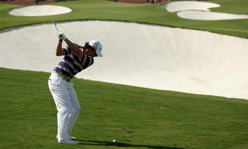 DUBAI, UNITED ARAB EMIRATES - NOVEMBER 21:  Rory McIlroy of Northern Ireland plays his second shot at the 1st hole during the third round of the Dubai World Championship, on the Earth Course, Jumeirah Golf Estates on November 21, 2009 in Dubai, United Arab Emirates  (Photo by David Cannon/Getty Images)