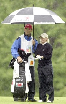 Becky Morgan waits to play in a downpour on her way to a 64 and the lead during the first round of the 2005 Wegman's Rochester LPGA at Locust Hill Country Club in  Pittsford, New York on June 16, 2005.Photo by Michael Cohen/WireImage.com