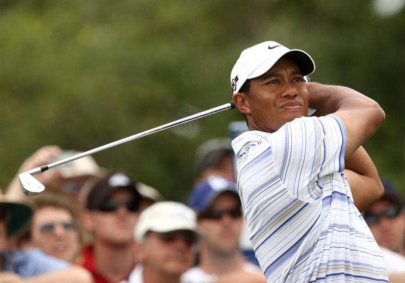 MELBOURNE, AUSTRALIA - NOVEMBER 14:  Tiger Woods of the USA tees off on the 3rd hole during round three of the 2009 Australian Masters at Kingston Heath Golf Club on November 14, 2009 in Melbourne, Australia.  (Photo by Quinn Rooney/Getty Images)