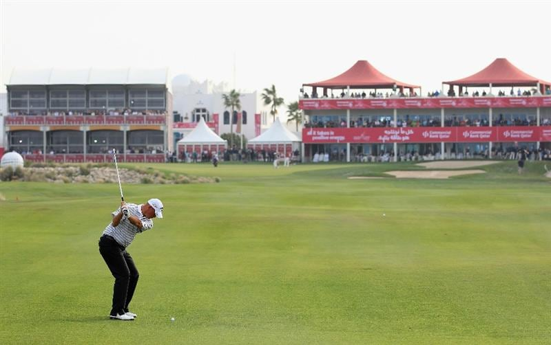 DOHA, QATAR - FEBRUARY 06:  Thomas Bjorn of Denmark plays his second shot on the 18th hole during the final round of the Commercialbank Qatar Masters held at Doha Golf Club on February 6, 2011 in Doha, Qatar.  (Photo by Andrew Redington/Getty Images)