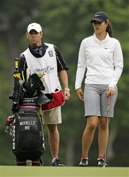 WILLIAMSBURG, VA - MAY 8: Michelle Wie and her caddie Kenny Harms stand on the 8th green during the first round of the Michelob Ultra Open at Kingsmill Resort & Spa on May 8, 2008 in Williamsburg, Virginia. (Photo by Hunter Martin/Getty Images)