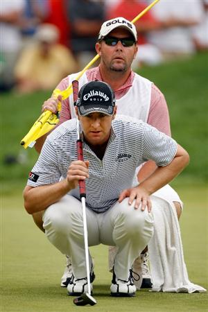 CHASKA, MN - AUGUST 15:  Brendan Jones of Australia lines up a putt with his caddie Scott Bint on the eighth green during the third round of the 91st PGA Championship at Hazeltine National Golf Club on August 15, 2009 in Chaska, Minnesota.  (Photo by Streeter Lecka/Getty Images)