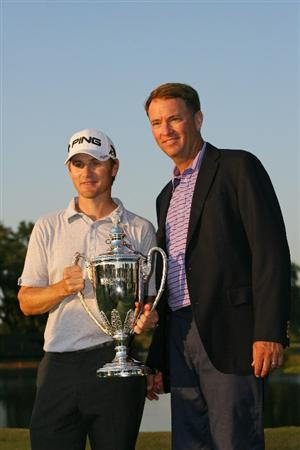 SEA ISLAND, GA - OCTOBER 10: Heath Slocum (L) poses with tournament host Davis Love III (R) and the championship trophy after winning the McGladrey Classic at Sea Island's Seaside Course on October 10, 2010 in Sea Island, Georgia. (Photo by Hunter Martin/Getty Images)