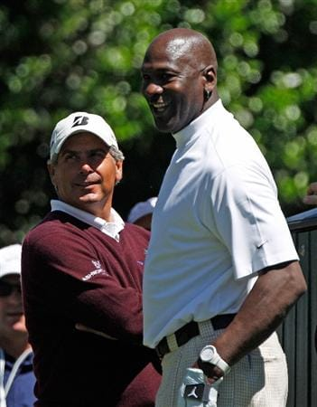 CHARLOTTE, NC - APRIL 28:  Basketball legend Michael Jordan (R) waits with Fred Couples on a tee box during the pro am prior to the start of the 2010 Quail Hollow Championship at the Quail Hollow Club on April 28, 2010 in Charlotte, North Carolina.  (Photo by Scott Halleran/Getty Images)