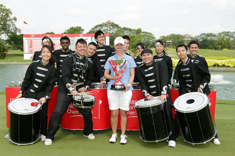 SINGAPORE - FEBRUARY 27:  Karrie Webb of Australia with the winners trophy after the final round of the HSBC Women's Champions at Tanah Merah Country Club  on February 27, 2011 in Singapore, Singapore.  (Photo by Ross Kinnaird/Getty Images)