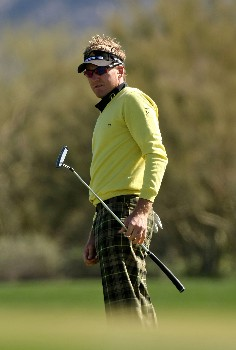 MARANA, AZ - FEBRUARY 21:  Ian Poulter of England watches a putt on the fourth hole during the second round matches of the WGC-Accenture Match Play Championship at The Gallery at Dove Mountain February 21, 2008 in Marana, Arizona.  (Photo by Stephen Dunn/Getty Images)