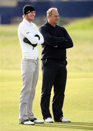ST ANDREWS, SCOTLAND - OCTOBER 01: Chris Wood of England (L) chats with Sir Steve Redgrave, former British Olympic rowing champion, on the second hole during the first round of The Alfred Dunhill Links Championship at The Old Course on October 1, 2009 in St. Andrews, Scotland.  (Photo by Andrew Redington/Getty Images)