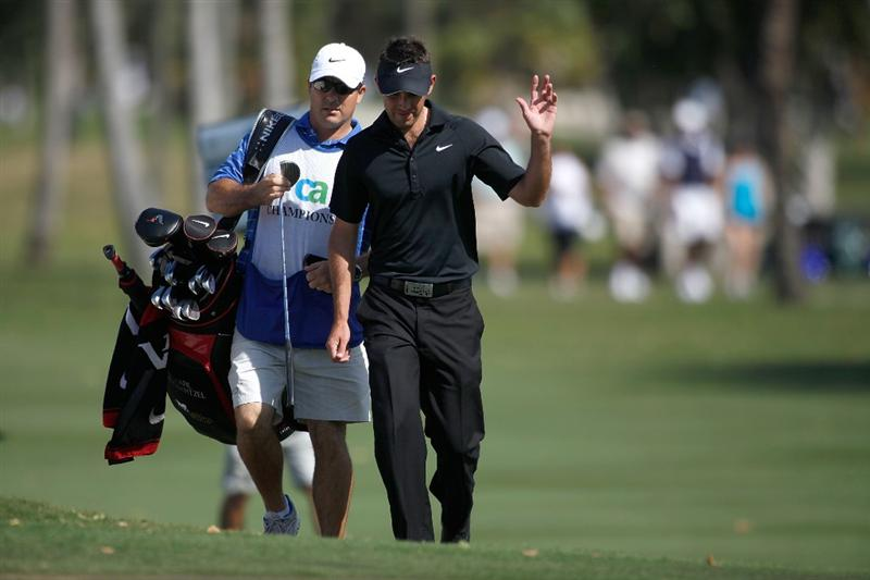 DORAL, FL - MARCH 14:  Charl Schwartzel of South Africa waves to the gallery on the eighth hole during the final round of the 2010 WGC-CA Championship at the TPC Blue Monster at Doral on March 14, 2010 in Doral, Florida.  (Photo by Marc Serota/Getty Images)