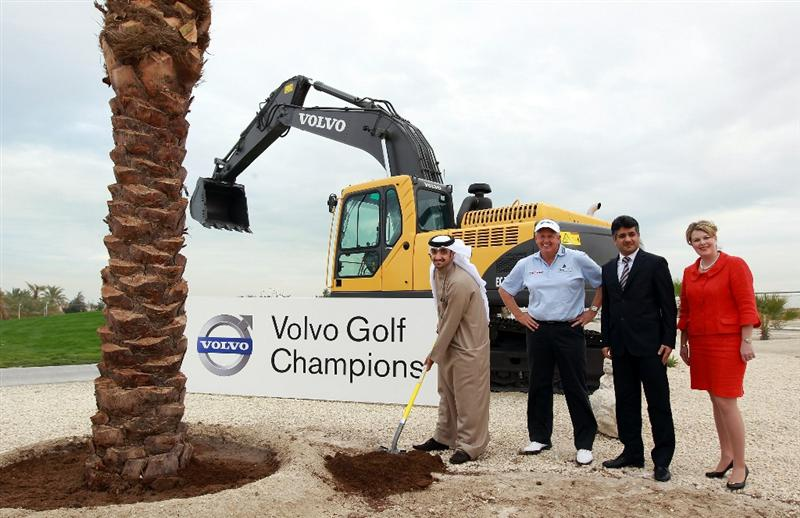 BAHRAIN, BAHRAIN - JANUARY 25:  Shaikh Abdulla Bin Salman Al Khalifa The President of the Bahrain Golf Association helps plant a commemorative tree beside the 1st tee watched by Colin Montgomerie of Scotland, Kamal Ahmed The Chief Operating Officer of The Bahrain Economic Development Board and Susan Stevenson The General Manager of The Royal Golf Club Bahrain as a preview for the 2011 Volvo Champions held at the Royal Golf Club on January 25, 2011 in Bahrain, Bahrain.  (Photo by David Cannon/Getty Images)
