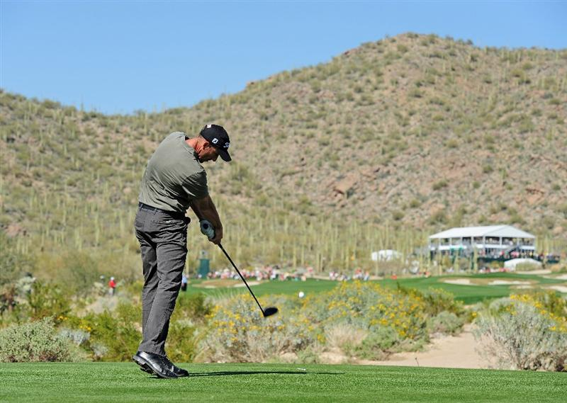 MARANA, AZ - FEBRUARY 18:  Geoff Ogilvy of Australia plays his tee shot on the 14th hole during round two of the Accenture Match Play Championship at the Ritz-Carlton Golf Club on February 18, 2010 in Marana, Arizona.  (Photo by Stuart Franklin/Getty Images)