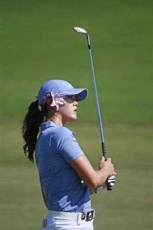 PRATTVILLE, AL - OCTOBER 1:  Michelle Wie watches her approach shot to the 18th hole during first round play in the Navistar LPGA Classic at the Robert Trent Jones Golf Trail at Capitol Hill on October 1, 2009 in  Prattville, Alabama.  (Photo by Dave Martin/Getty Images)