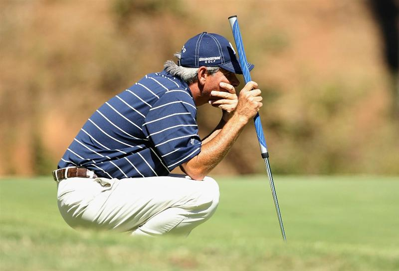 CONOVER, NC - OCTOBER 02:  Fred Couples lines up a putt on the sixth hole green during the second round of the Ensure Classic at the Rock Barn Golf & Spa on October 2, 2010 in Conover, North Carolina.  (Photo by Christian Petersen/Getty Images)