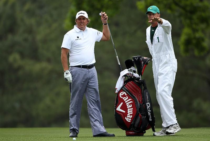 AUGUSTA, GA - APRIL 09:  Phil Mickelson chats with his caddie Jim Mackay on the first hole during the third round of the 2011 Masters Tournament at Augusta National Golf Club on April 9, 2011 in Augusta, Georgia.  (Photo by Andrew Redington/Getty Images)