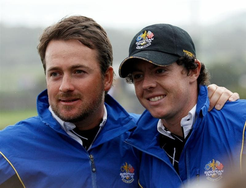 NEWPORT, WALES - OCTOBER 03:  Rory McIlroy of Europe and Graeme McDowell (L) support their team mates during the  Fourball & Foursome Matches during the 2010 Ryder Cup at the Celtic Manor Resort on October 3, 2010 in Newport, Wales.  (Photo by Sam Greenwood/Getty Images)