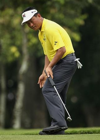 KUALA LUMPUR, MALAYSIA - MARCH 07:  KJ Choi of Korea reacst after a missed putt on the 13th hole during the the final round of the Maybank Malaysian Open at the Kuala Lumpur Golf and Country Club on March 7, 2010 in Kuala Lumpur, Malaysia.  (Photo by Andrew Redington/Getty Images)