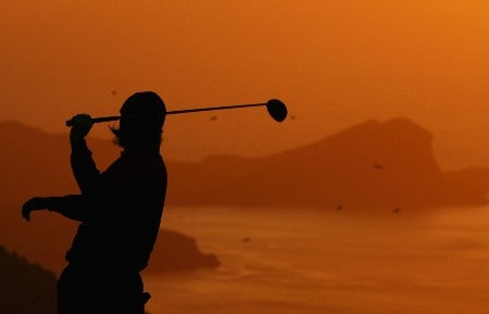 MADEIRA, PORTUGAL - MARCH 22:  A golfer warms up on the practice range at sunrise during Round Three of the Madeira Islands Open BPI 2008 at Clube De Golf Santo Da Serra on March 22, 2008 in Madeira, Portugal.  (Photo by Ryan Pierse/Getty Images)
