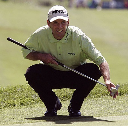 Kevin Sutherland of San Antonio, Texas, lines up a putt on 18 during the first round of the Buick Championship at Tournament Player Club at River Highlands, in Cromwell, Connecticut, Thursday, August 25, 2005. He finished with a 5-under-par 65.Photo by Jim Rogash/WireImage.com