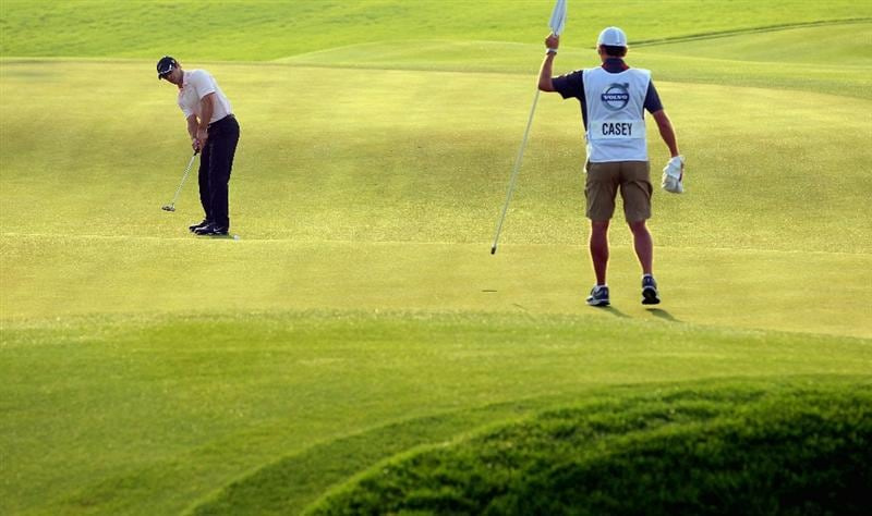 BAHRAIN, BAHRAIN - JANUARY 30:  Paul Casey of England putts on the 16th hole during the final round of the Volvo Golf Champions at The Royal Golf Club on January 30, 2011 in Bahrain, Bahrain.  (Photo by Andrew Redington/Getty Images)