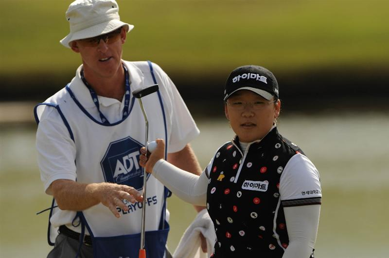 WEST PALM BECH, FL - NOVEMBER 23:  Ji-Yai Shin of South Korea hands her club and ball to her caddie on the 16th hole during the final round of the ADT Championship at the Trump International Golf Club on November 23, 2008 in West Palm Beach, Florida.  (Photo by Montana Pritchard/Getty Images)