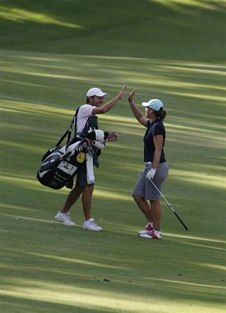 GUADALAJARA, MEXICO - NOVEMBER 14:  Karine Icher of France celebrates with her caddie after making an eagle from the 18th fairway during the final round of the Lorena Ochoa Invitational Presented by Banamex and Corona Light at Guadalajara Country Club on November 14, 2010 in Guadalajara, Mexico.  (Photo by Michael Cohen/Getty Images)