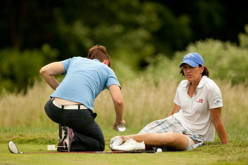 SPRINGFIELD, IL - JUNE 12: Juli Inkster receives on-course treatment for a blister during the third round of the LPGA State Farm Classic at Panther Creek Country Club on June 12, 2010 in Springfield, Illinois. (Photo by Darren Carroll/Getty Images)