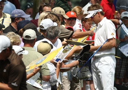 BLOOMFIELD HILLS, MI - AUGUST 05:  Ian Poutler of England (R) signs his autograph for fans during a practice round prior to the 90th PGA Championship at Oakland Hills Country Club on August 5, 2008 in Bloomfield Township, Michigan.  (Photo by David Cannon/Getty Images)
