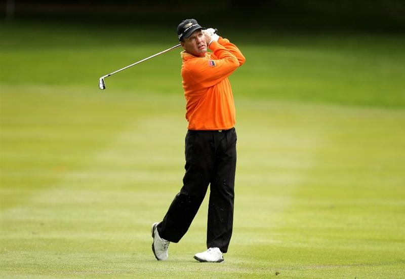 VIRGINIA WATER, ENGLAND - MAY 26:  Thomas Levet of France hits an approach shot during the first round of the BMW PGA Championship at Wentworth Club on May 26, 2011 in Virginia Water, England.  (Photo by Ian Walton/Getty Images)