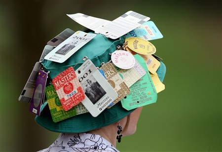 AUGUSTA, GA - APRIL 08:  A patron shows her badges during the second day of practice prior to the start of the 2008 Masters Tournament at Augusta National Golf Club on April 8, 2008 in Augusta, Georgia.  (Photo by Andrew Redington/Getty Images)