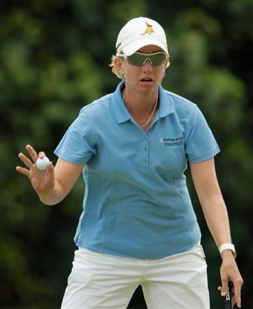SINGAPORE - FEBRUARY 27:  Karrie Webb of Australia waves to the gallery on the 13th green during the final round of the HSBC Women's Champions 2011 at the Tanah Merah Country Club on February 27, 2011 in Singapore, Singapore.  (Photo by Scott Halleran/Getty Images)
