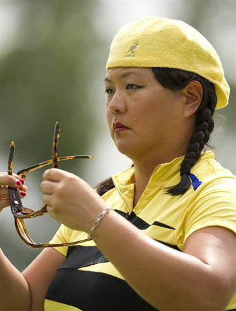 CHON BURI, THAILAND - FEBRUARY 21:  Christina Kim of USA changes her two pair of sunglasses during the final round of the Honda PTT LPGA Thailand at Siam Country Club on February 21, 2010 in Chon Buri, Thailand.  (Photo by Victor Fraile/Getty Images)
