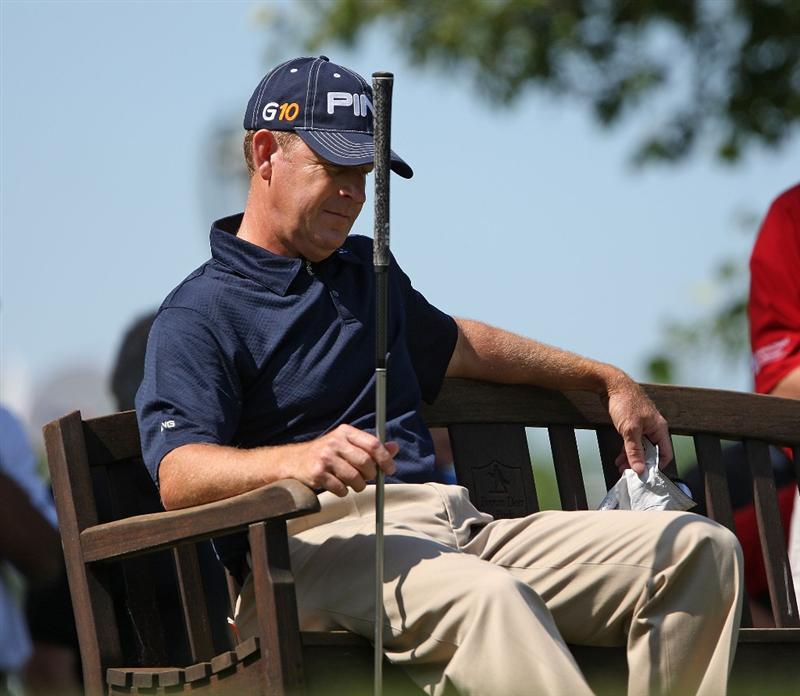 MILWAUKEE - JULY 19: Jeff Maggert sits on the bench and waits to tee of on the 10th hole during the final round of the U.S. Bank Championship on July 19, 2009 at the Brown Deer Park golf course in Milwaukee, Wisconsin. (Photo by Jonathan Daniel/Getty Images)