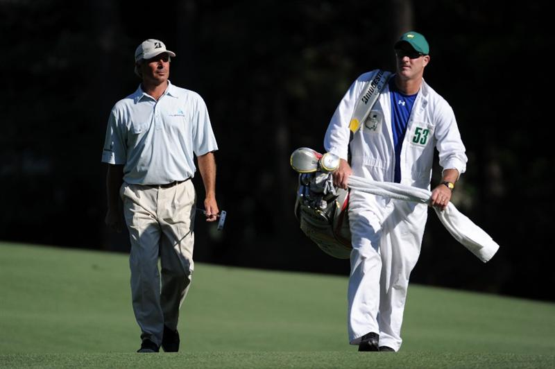 AUGUSTA, GA - APRIL 11:  Fred Couples walks up the 13th fairway alongside his caddie Joe Lacava during the final round of the 2010 Masters Tournament at Augusta National Golf Club on April 11, 2010 in Augusta, Georgia.  (Photo by Harry How/Getty Images)