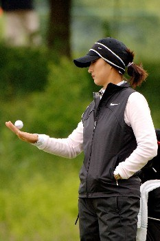 Grace Park balances a ball while waiting to play the 12th hole   April 30 in  the rain-delayed third  round of the 2005 Franklin American Mortgage Championship in Franklin, TN.Photo by Al Messerschmidt/WireImage.com