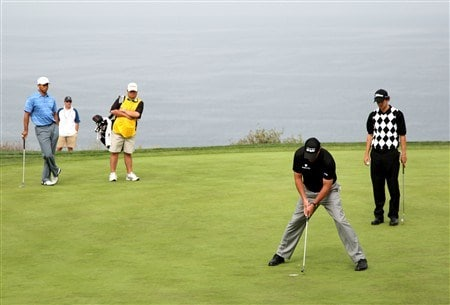 SAN DIEGO - JUNE 12:  Tiger Woods (L) and Adam Scott of Australia (R) watch as Phil Mickelson (C) putts on the fourth green during the first round of the 108th U.S. Open at the Torrey Pines Golf Course (South Course) on June 12, 2008 in San Diego, California.  (Photo by Ross Kinnaird/Getty Images)