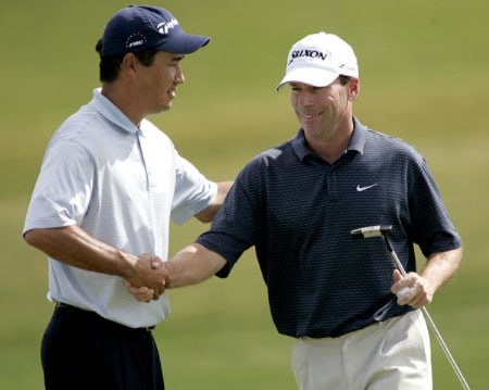 Dean Wilson, left, shakes hands with John Huston after the final round of the 2005 Michelin Championship at Las  Vegas Sunday, Oct. 16, 2005, at the The Players Club at Summerlin in Las Vegas, Nevada.Photo by Grant Halverson/WireImage.com