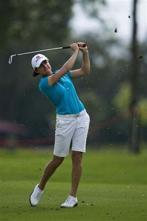 CHON BURI, THAILAND - FEBRUARY 21:  Lorena Ochoa of Mexico plays an approach shot on the 14th hole during the final round of the Honda PTT LPGA Thailand at Siam Country Club on February 21, 2010 in Chon Buri, Thailand.  (Photo by Victor Fraile/Getty Images)