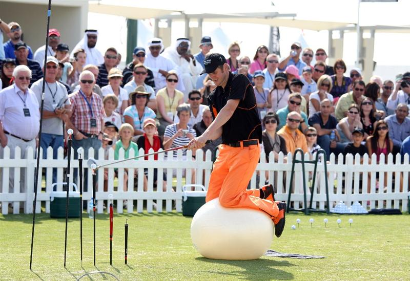 RIFFA, BAHRAIN - NOVEMBER 14:  Kevin Carpenter of England performs on a gym ball in his 'trick shot show' as part of the celebration of the completion of construction of the Montgomerie Course at Riffa Views on November 14, 2008 in Riffa, Bahrain  (Photo by David Cannon/Getty Images)
