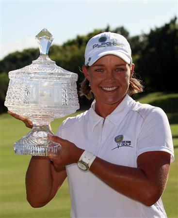 BRISBANE, AUSTRALIA - FEBRUARY 08: Katherine Hull of Australia poses with the winners trophy after day four of the 2009 ANZ Ladies Masters at Royal Pines Resort on February 8, 2009 in Brisbane, Australia.  (Photo by Bradley Kanaris/Getty Images)