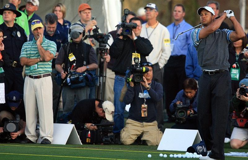MARANA, AZ - FEBRUARY 24:  Tiger Woods watches a shot on the practice ground as members of the media look on during a practice round prior to the start of the Accenture Match Play Championship at the Ritz-Carlton Golf Club at Dove Mountain on February 24, 2009 in Marana, Arizona.  (Photo by Scott Halleran/Getty Images)