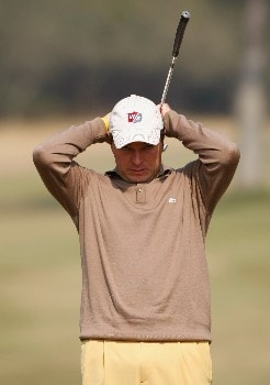 NEW DELHI, INDIA - FEBRUARY 09:  Jose Manuel Lara of Spain reacts to his putt on the third hole during the third round of the Emaar-MGF Indian Masters at the Delhi Golf Club on February 9, 2008 in Delhi, India.  (Photo by Stuart Franklin/Getty Images)