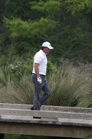 HUMBLE, TX - APRIL 01:  Phil Mickelson crosses a bridgeduring the second round of the Shell Houston Open at Redstone Golf Club on April 1, 2011 in Humble, Texas.  (Photo by Michael Cohen/Getty Images)