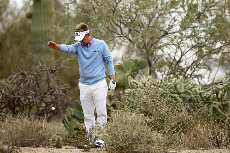 MARANA, AZ - FEBRUARY 26:  Luke Donald of England takes a drop on the 11th hole during the semifinal round of the Accenture Match Play Championship at the Ritz-Carlton Golf Club on February 26, 2011 in Marana, Arizona.  (Photo by Andy Lyons/Getty Images)