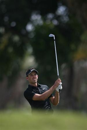 DORAL, FL - MARCH 14:  Charl Schwartzel of South Africa plays a shot on the second hole during the final round of the 2010 WGC-CA Championship at the TPC Blue Monster at Doral on March 14, 2010 in Doral, Florida.  (Photo by Marc Serota/Getty Images)