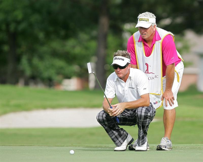 MEMPHIS, TN - JUNE 14:  Brian Gay of the U.S. lines up a putt on the 16th green during the final round of the St. Jude Classic at TPC Southwind held on June 14, 2009 in Memphis, Tennessee.  (Photo by Michael Cohen/Getty Images)