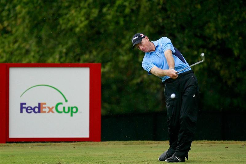 ATLANTA - SEPTEMBER 26:  Jim Furyk hit a shot on the 11th hole during the final round of THE TOUR Championship presented by Coca-Cola at East Lake Golf Club on September 26, 2010 in Atlanta, Georgia.  (Photo by Kevin C. Cox/Getty Images)