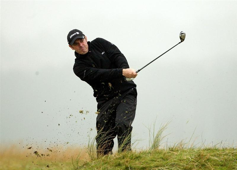 ST ANDREWS, SCOTLAND - OCTOBER 08:  Paul McGinley of Ireland plays his second shot into the third green during the second round of The Alfred Dunhill Links Championship at The Old Course on October 8, 2010 in St Andrews, Scotland.  (Photo by Warren Little/Getty Images)