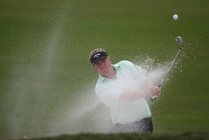 DORAL, FL - MARCH 11:  Ross McGowan of England hits out of the bunker on the tenth hole during round one of the 2010 WGC-CA Championship at the TPC Blue Monster at Doral on March 11, 2010 in Doral, Florida.  (Photo by Marc Serota/Getty Images)